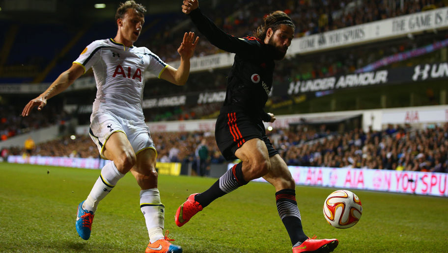 LONDON, ENGLAND - OCTOBER 02: Vlad Chiriches of Spurs marshalls Olcay Sahan of Besiktas  during the UEFA Europa League Group C match between Tottenham Hotspur FC and Besiktas JK at White Hart Lane on October 2, 2014 in London, United Kingdom.  (Photo by Ian Walton/Getty Images)