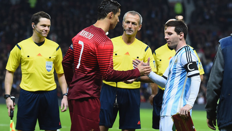 MANCHESTER, ENGLAND - NOVEMBER 18:  Lionel Messi of Argentina shakes hands with Cristiano Ronaldo of Portugal prior to the International Friendly match between Argentina and Portugal at Old Trafford on November 18, 2014 in Manchester, England.  (Photo by Laurence Griffiths/Getty Images)