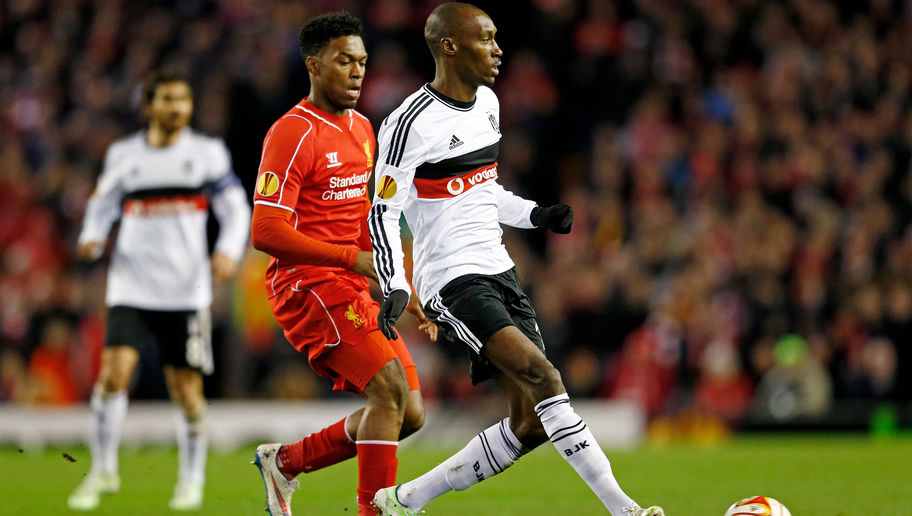 LIVERPOOL, ENGLAND - FEBRUARY 19:  Atiba Hutchinson of Besiktas passes the ball as Daniel Sturridge of Liverpool closes in during the UEFA Europa League Round of 32 match between Liverpool FC and Besiktas JK at Anfield on February 19, 2015 in Liverpool, United Kingdom.  (Photo by Julian Finney/Getty Images)