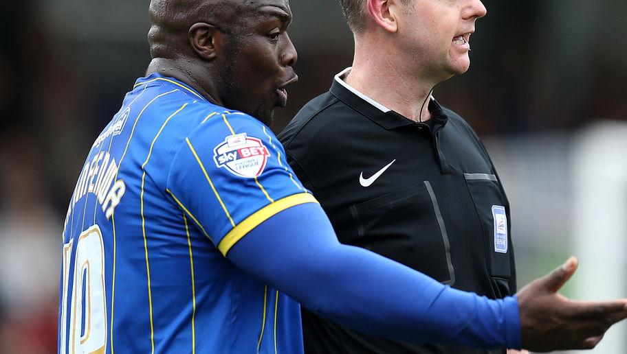 KINGSTON UPON THAMES, ENGLAND - APRIL 03:  Adebayo Akinfenwa of AFC Wimbledon makes a point to referee Chris Sarginson during the Sky Bet League Two match between AFC Wimbledon and Northampton Town at The Cherry Red Records Stadium on April 3, 2015 in Kingston upon Thames, England.  (Photo by Pete Norton/Getty Images)