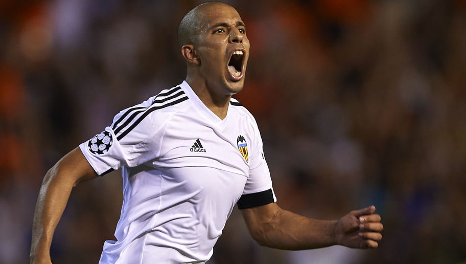 VALENCIA, SPAIN - AUGUST 19:  Sofiane Feghouli of Valencia celebrates scoring his team's third goal during the UEFA Champions League Qualifying Round Play Off First Leg match between Valencia CF and AS Monaco at Mestalla Stadium on August 19, 2015 in Valencia, Spain.  (Photo by Manuel Queimadelos Alonso/Getty Images)