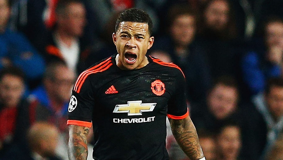 EINDHOVEN, NETHERLANDS - SEPTEMBER 15:  Memphis Depay of Manchester United celebrates as he scores their first goal during the UEFA Champions League Group B match between PSV Eindhoven and Manchester United at PSV Stadion on September 15, 2015 in Eindhoven, Netherlands.  (Photo by Dean Mouhtaropoulos/Getty Images)