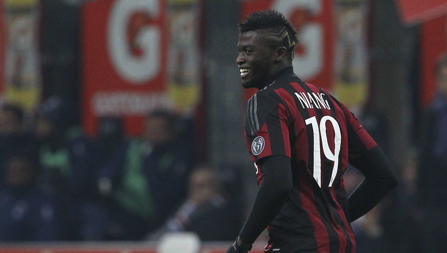 MILAN, ITALY - NOVEMBER 28:  M Baye Niang of AC Milan celebrates his second goal during the Serie A match between AC Milan and UC Sampdoria at Stadio Giuseppe Meazza on November 28, 2015 in Milan, Italy.  (Photo by Marco Luzzani/Getty Images)