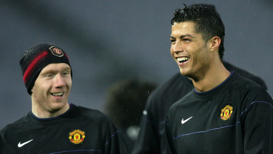 YOKOHAMA, JAPAN - DECEMBER 17:  (L-R) Paul Scholes and Cristiano Ronaldo of Manchester United laugh during a training session at the International Stadium Yokohama on December 17, 2008 in Yokohama, Kanagawa, Japan. Manchester United will play  Gamba Osaka in the FIFA Club World Cup Japan 2008 Semi Final on December 18.  (Photo by Kiyoshi Ota/Getty Images)