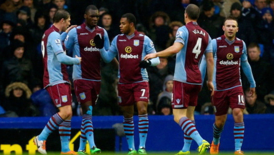 LIVERPOOL, ENGLAND - FEBRUARY 01: Leandro Bacuna (C) of Aston Villa celebrates after scoring a goal with team mates during the Barclays Premier League match between Everton and Aston Villa at Goodison Park on February 1, 2014 in Liverpool, England. (Photo by Paul Thomas/Getty Images)