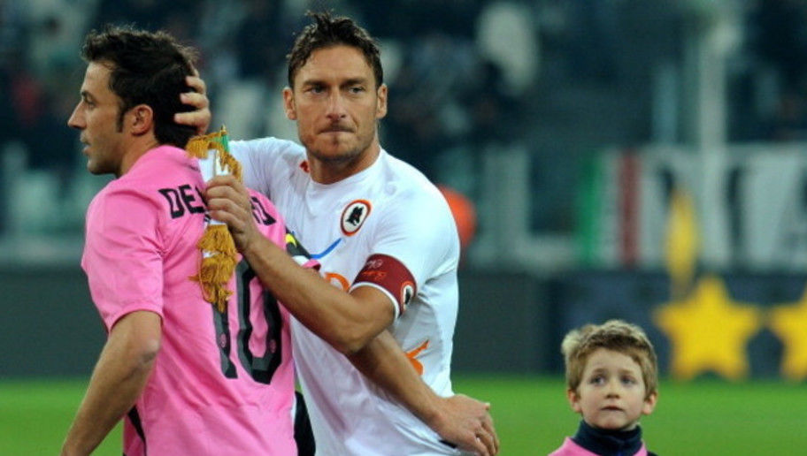 TURIN, ITALY - JANUARY 24:  Francesco Totti (R) of AS Roma salutes Alessandro Del Piero of Juventus FC prior to the Tim Cup match between Juventus FC and AS Roma at Juventus Arena on January 24, 2012 in Turin, Italy.  (Photo by Valerio Pennicino/Getty Images)