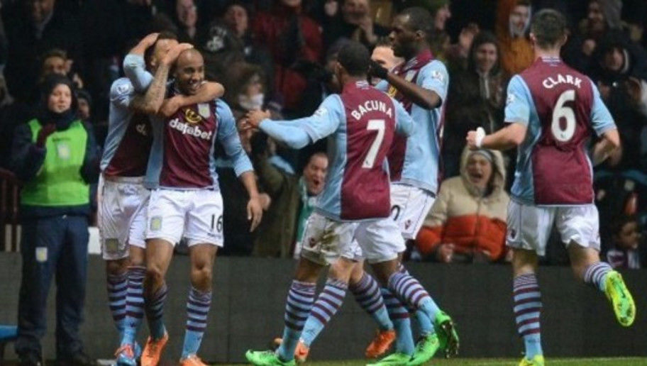 Aston Villa's English midfielder Fabian Delph (2-L) celebrates after scoring his teams third goal during the English Premier League football match between Aston Villa and West Bromwich Albion at Villa Park in Birmingham on January 29, 2014.  AFP PHOTO/ANDREW YATES -