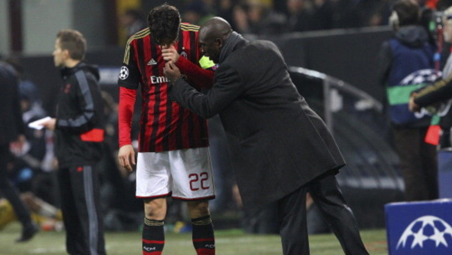 MILAN, ITALY - FEBRUARY 19:  AC Milan coach Clarence Seedorf (R) issues instructions to his player Ricardo Kaka (L) during the UEFA Champions League Round of 16 match between AC Milan and Club Atletico de Madrid at Stadio Giuseppe Meazza on February 19, 2014 in Milan, Italy.  (Photo by Marco Luzzani/Getty Images)