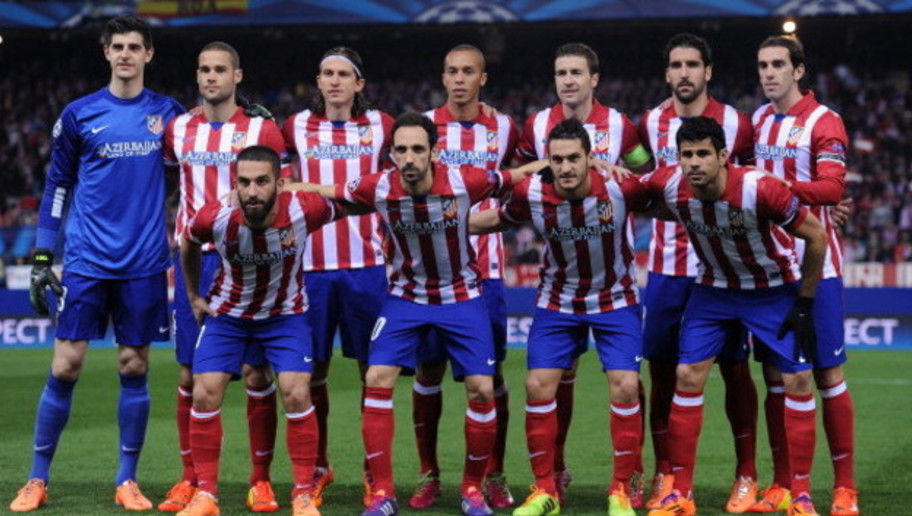 MADRID, SPAIN - MARCH 11:  Club Atletico de Madrid players line-up before the start of the UEFA Champions League Round of 16, 2nd leg match between Club Atletico de Madrid v AC Milan at Vicente Calderon Stadium on March 11, 2014 in Madrid, Spain.  (Photo by Denis Doyle/Getty Images)
