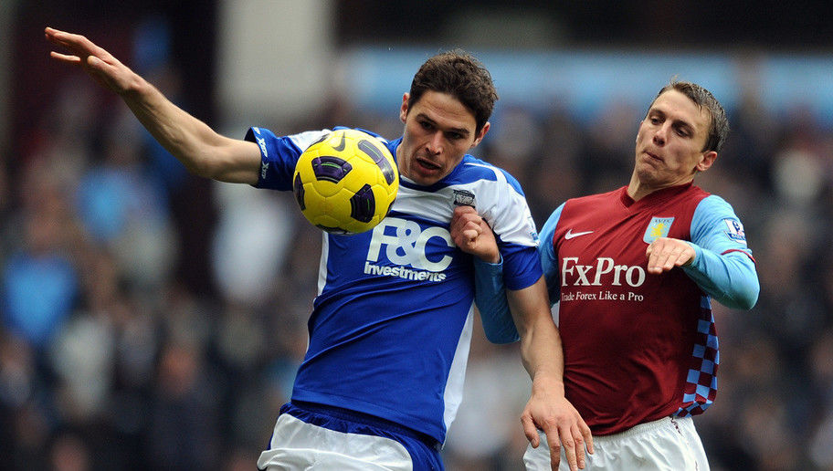 Stephen Warnock of Aston Villa competes with Nikola Zigic of Birmingham City during the Barclays Premier League match between Aston Villa and Birmingham City at Villa Park on October 31, 2010 in Birmingham, England