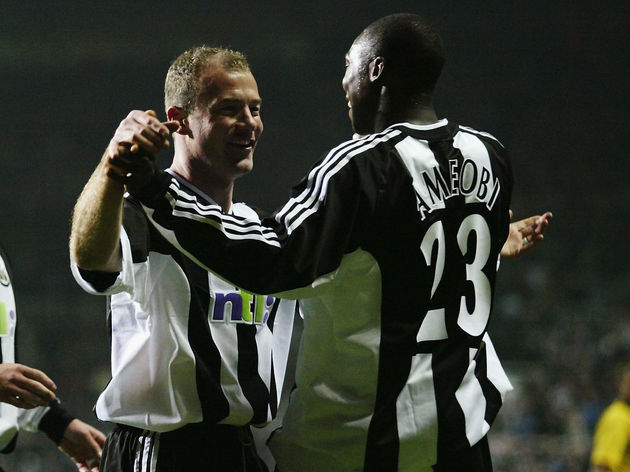 Alan Shearer of Newcastle United celebrates scoring the second goal with team-mate Shola Ameobi