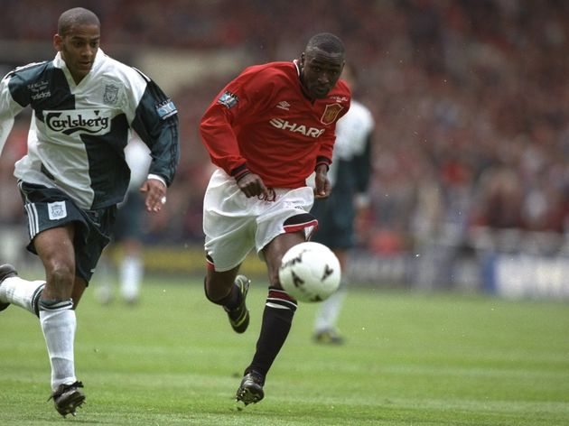 Andy Cole of Manchester United and Phil Babb of Liverpool