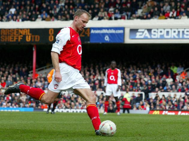 Arsenal's Dennis Bergkamp takes a shot a