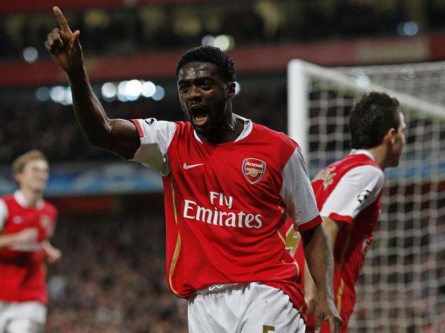Arsenal's Kolo Toure (C) celebrates afte