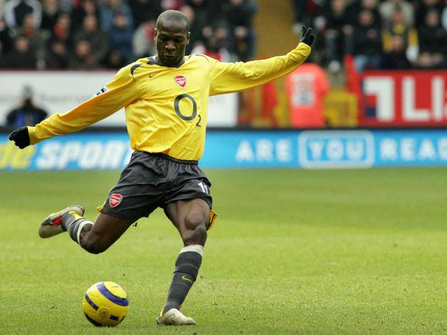 Arsenal's Lauren shoots for a goal durin