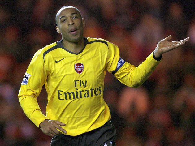 Arsenal's Thierry Henry celebrates scori...