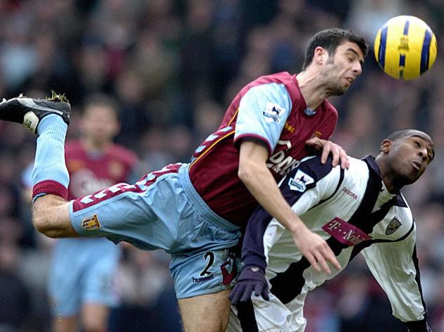 Aston Villa 's Mark Delaney heads the ba
