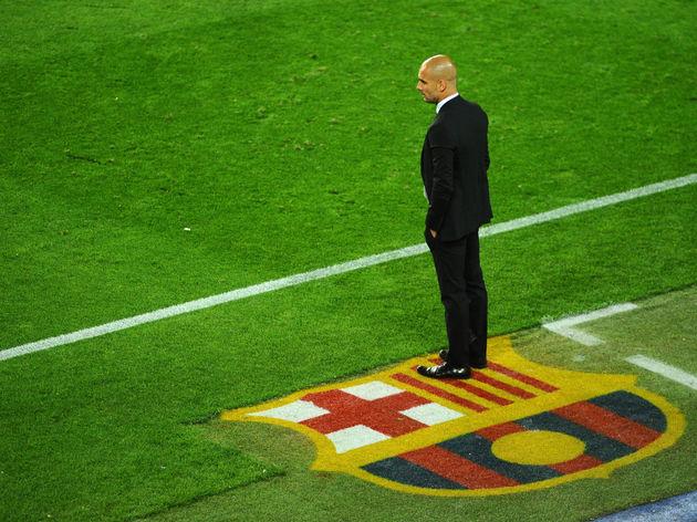 Barcelona's coach Josep Guardiola watche