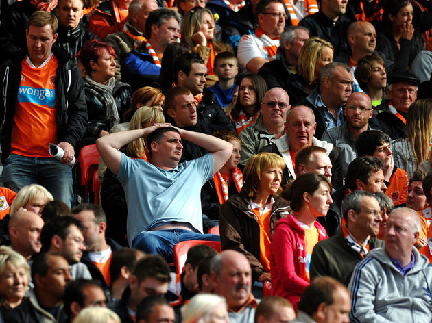 Blackpool fans react during the English
