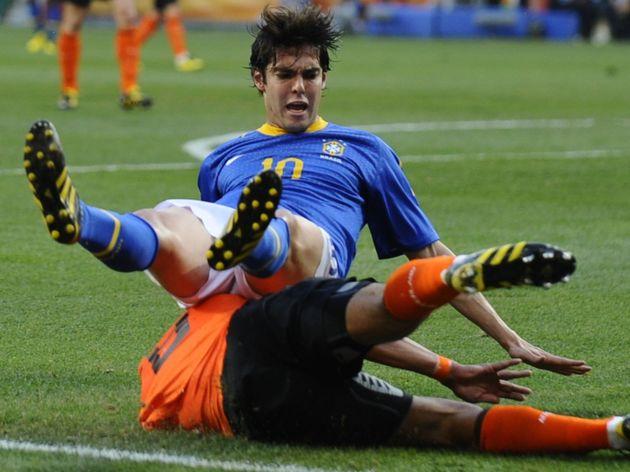 Brazil's midfielder Kaka falls over Neth