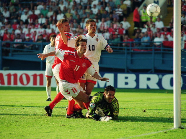 Brian Laudrup of Denmark comes close to scoring as he hits the post