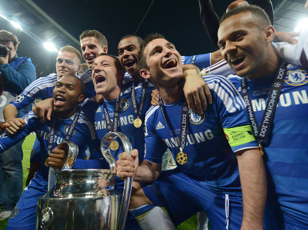 Chelsea's players pose with the trophy a