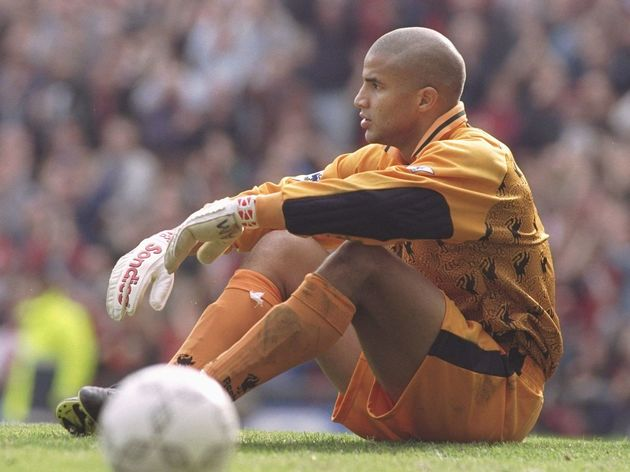 David James of Liverpool sits dejected