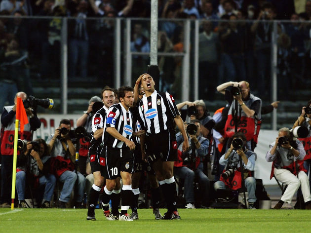 David Trezeguet of Juventus celebrates his goal in front of the photographers