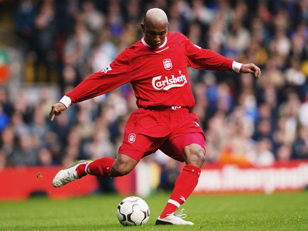 El Hadji Diouf of Liverpool strikes the ball