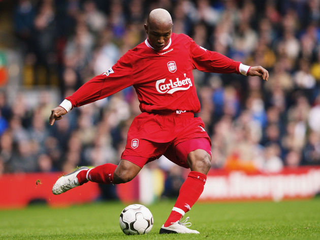 El Hadji Diouf of Liverpool strikes the ball
