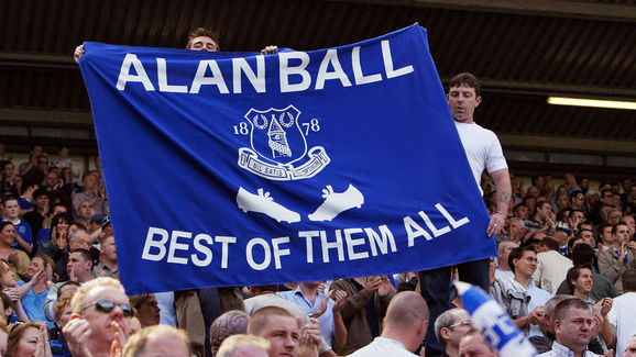Everton supporters hold a banner in memo...