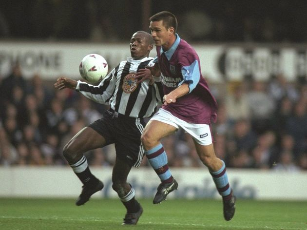 Faustino Asprilla of Newcastle (left) tangles with Steve Potts of West Ham