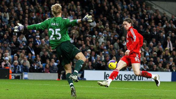 Fernando Torres (R) of Liverpool beats J