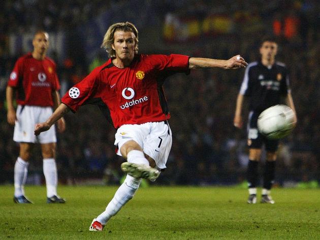 (FILE PHOTO) David Beckham of Man Utd scores the 3rd goal