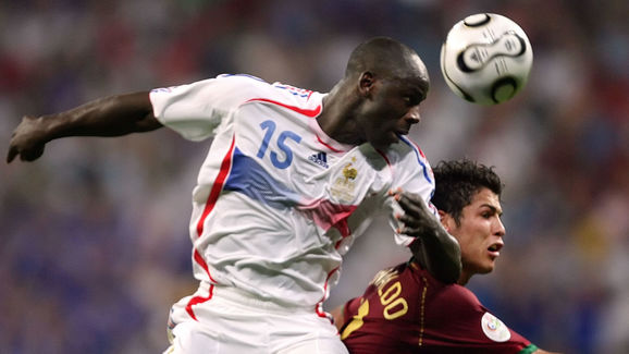 French defender Lilian Thuram (L) heads