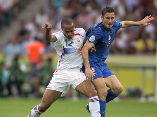 French forward Thierry Henry(L) hides th