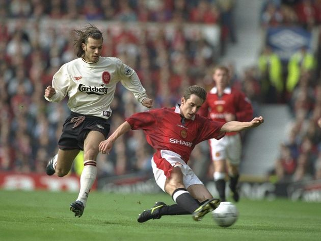 Gary Neville of Manchester United (right) slides into clear the ball, ahead of a surging Patrik Berg