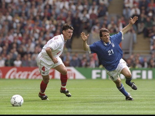 Gianfranco Zola of Italy (number 21) attempts to go round Ilia Tsimbalar of Russia