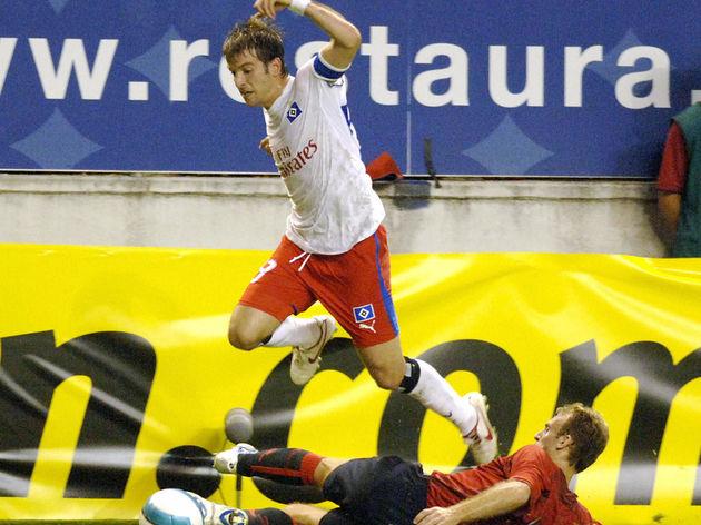Hamburg's Rafael Van Der Vaart jumps ove