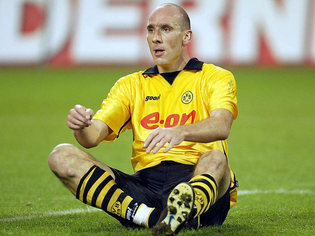 Jan Koller of Dortmund looks on