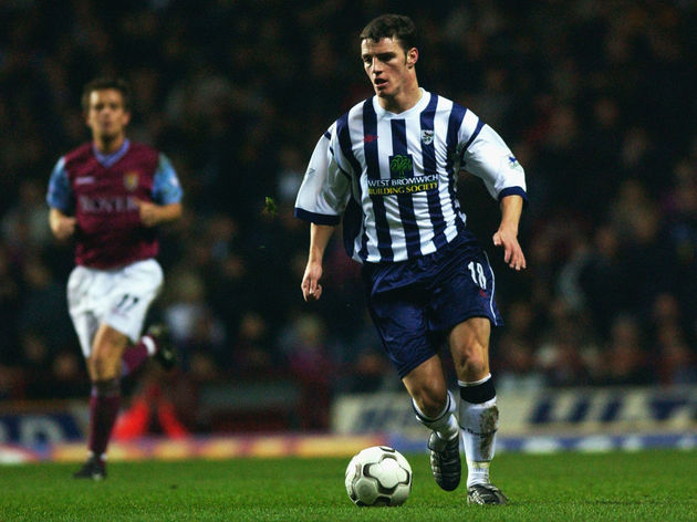 Jason Koumas of West Bromwich Albion running with the ball at his feet