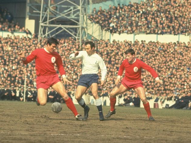 Jimmy Greaves sneaks in between Ron Yeats and Tommy Smith to take the ball