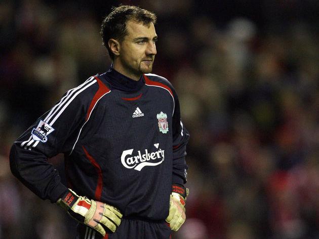 Liverpool goalkeeper Jerzy Dudek stands