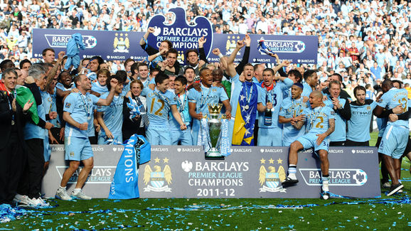 Manchester City players celebrate with t