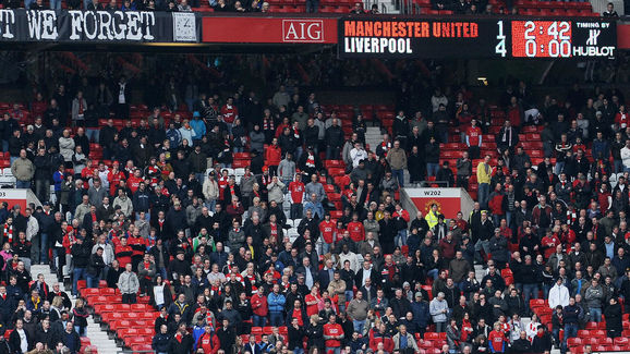 Manchester United supporters leave the g