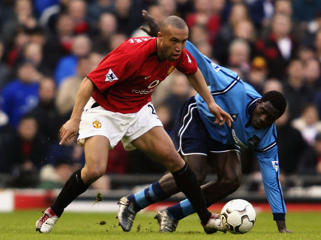 Mikael Silvestre of Manchester United and Marc-Vivien Foe of Manchester City