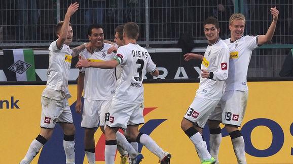 Moenchengladbach scorers Marco Reus (L),