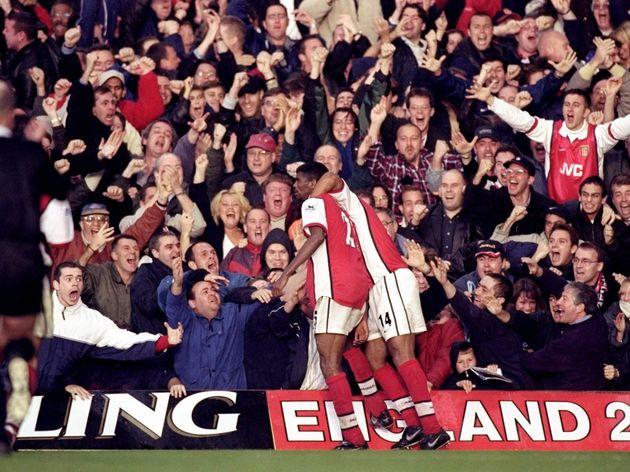 Nwankwo Kanu and Thierry Henry of Arsenal