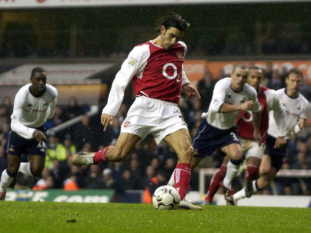 Robert Pires of Arsenal scores from the penalty spot
