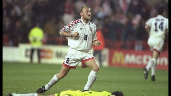 Robert Prosinecki of Croatia (number 8) celebrates